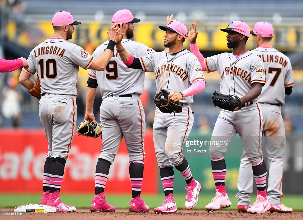 Gregor Blanco #1 and Andrew McCutchen #22 of the San Francisco Giants celebrate with teammates after a 5-0 win over the Pittsburgh Pirates at PNC Park on May 13, 2018 in Pittsburgh, Pennsylvania.