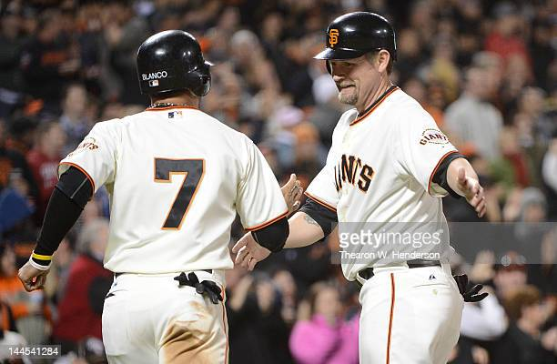 Gregor Blanco and Aubrey Huff of the San Francisco Giants celebrates after scoring on a tworun double by Melky Cabrera in the seventh inning against...