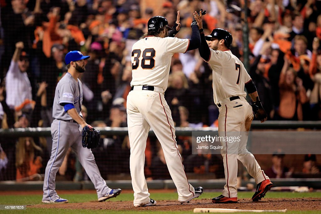 Gregor Blanco #7 and Michael Morse #38 of the San Francisco Giants celebrate after scoring on a two-run double by Joe Panik #12 in the seventh inning against the Kansas City Royals during Game Four of the 2014 World Series at AT&T Park on October 25, 2014 in San Francisco, California.