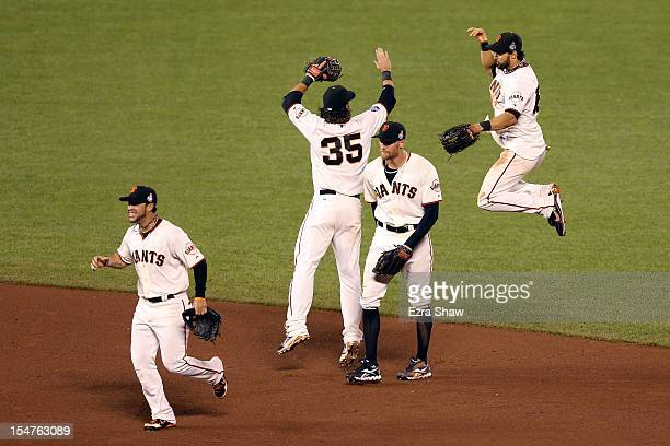 Gregor Blanco Brandon Crawford Hunter Pence and Angel Pagan of the San Francisco Giants celebrate after they won 20 against the Detroit Tigers during...