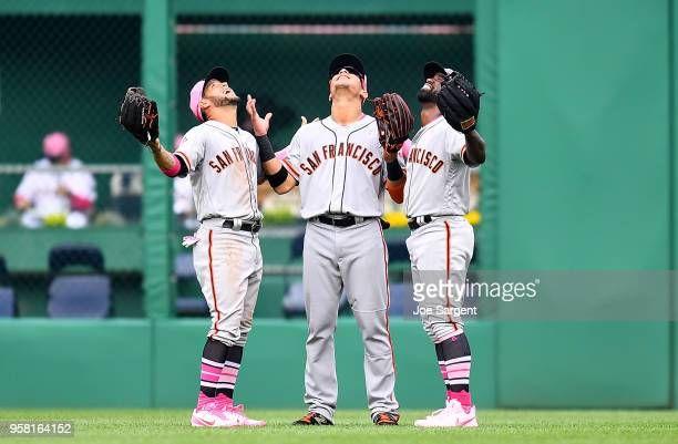 Gregor Blanco Gorkys Hernandez and Andrew McCutchen of the San Francisco Giants celebrate after a 50 win over the Pittsburgh Pirates at PNC Park on...