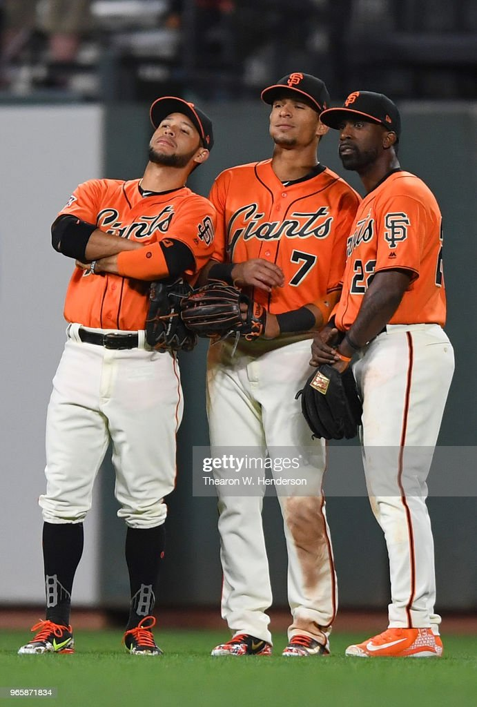 Gregor Blanco #1, Gorkys Hernandez #7 and Andrew McCutchen #22 of the San Francisco Giants celebrates defeating the Philadelphia Phillies 4-0 at AT&T Park on June 1, 2018 in San Francisco, California.