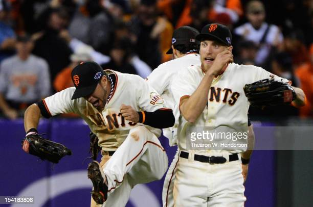 Gregor Blanco Hunter Pence and Angel Pagan of the San Francisco Giants celebrate their 7 to 1 win over the St Louis Cardinals in Game Two of the...