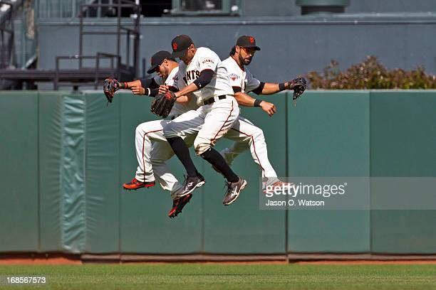 Gregor Blanco Hunter Pence and Angel Pagan of the San Francisco Giants celebrate after the game against the Atlanta Braves at ATT Park on May 11 2013...