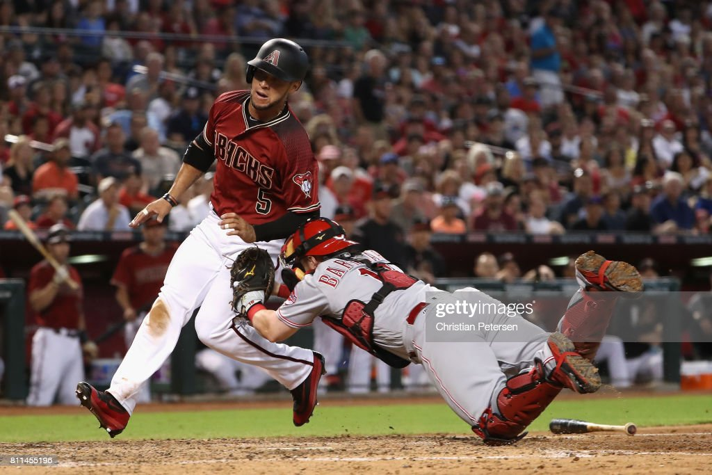 Gregor Blanco #5 of the Arizona Diamondbacks is tagged out by catcher Tucker Barnhart #16 of the Cincinnati Reds as he attempts to score during the fifth inning of the MLB game at Chase Field on July 9, 2017 in Phoenix, Arizona.