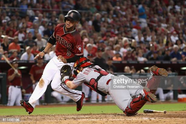 Gregor Blanco of the Arizona Diamondbacks is tagged out by catcher Tucker Barnhart of the Cincinnati Reds as he attempts to score during the fifth...