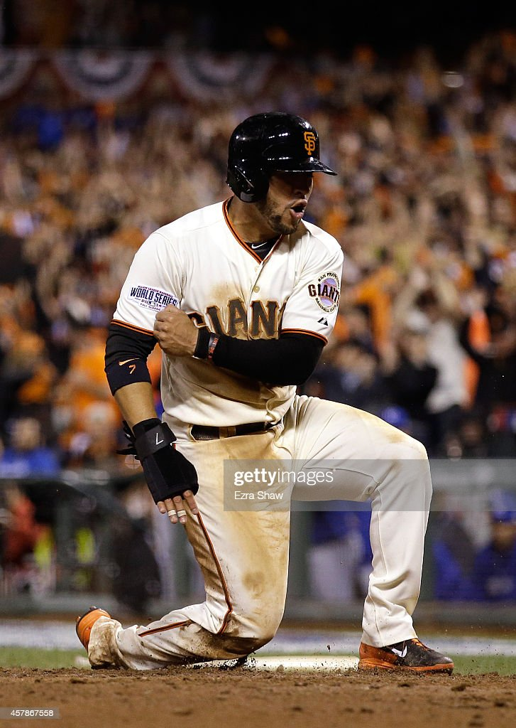 Gregor Blanco #7 of the San Francisco Giants celebrates after scoring in the seventh inning against the Kansas City Royals during Game Four of the 2014 World Series at AT&T Park on October 25, 2014 in San Francisco, California.