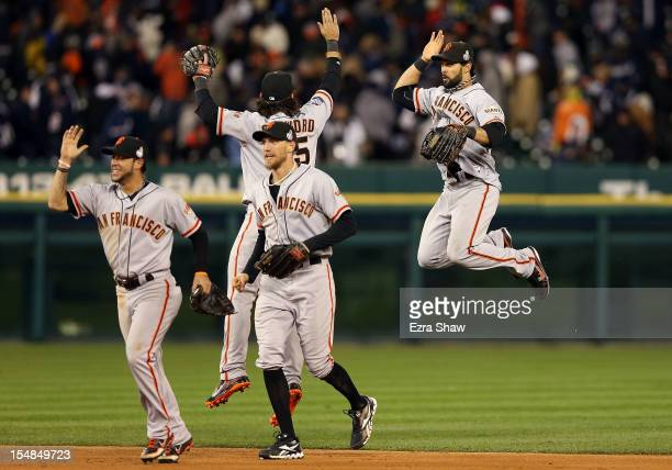 Gregor Blanco of the San Francisco Giants celebrates with teammates Hunter Pence Brandon Crawford and Angel Pagan after defeating the Detroit Tigers...
