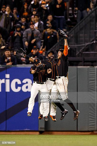 Gregor Blanco of the San Francisco Giants Denard Span and Hunter Pence celebrate in the outfield after the game against the Colorado Rockies at ATT...