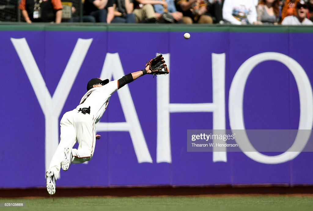 Gregor Blanco #7 of the San Francisco Giants dives to rob Derek Norris #3 of the San Diego Padres of a hit in the top of the eighth inning at AT&T Park on April 27, 2016 in San Francisco, California.