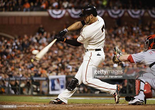 Gregor Blanco of the San Francisco Giants hits a double in the second inning against the Cincinnati Reds in Game One of the National League Division...