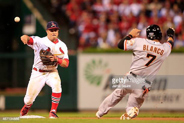 Gregor Blanco of the San Francisco Giants is out at second as Kolten Wong of the St Louis Cardinals turns the double play on a ball hit by Joe Panik...
