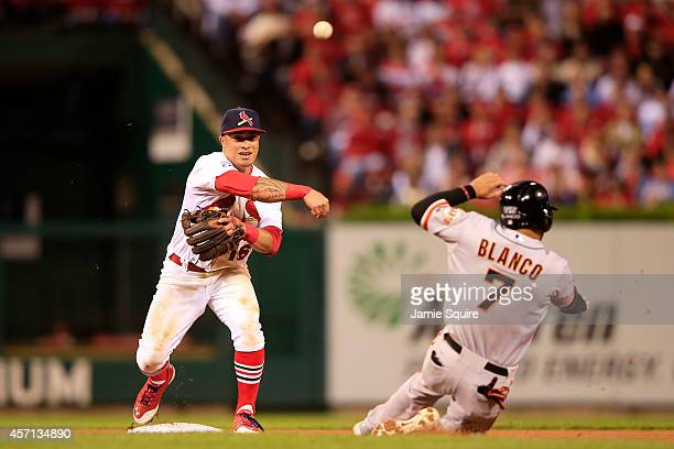 Gregor Blanco of the San Francisco Giants is out at second as Kolten Wong of the St. Louis Cardinals turns the double play on a ball hit by Joe Panik...