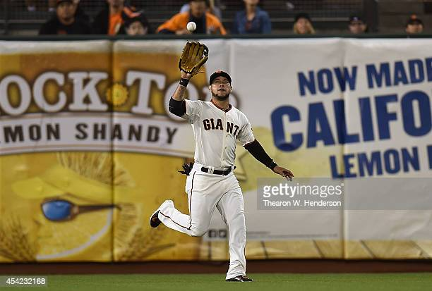 Gregor Blanco of the San Francisco Giants makes a running catch in left centerfield off the bat of Nolan Arenado of the Colorado Rockies in the top...