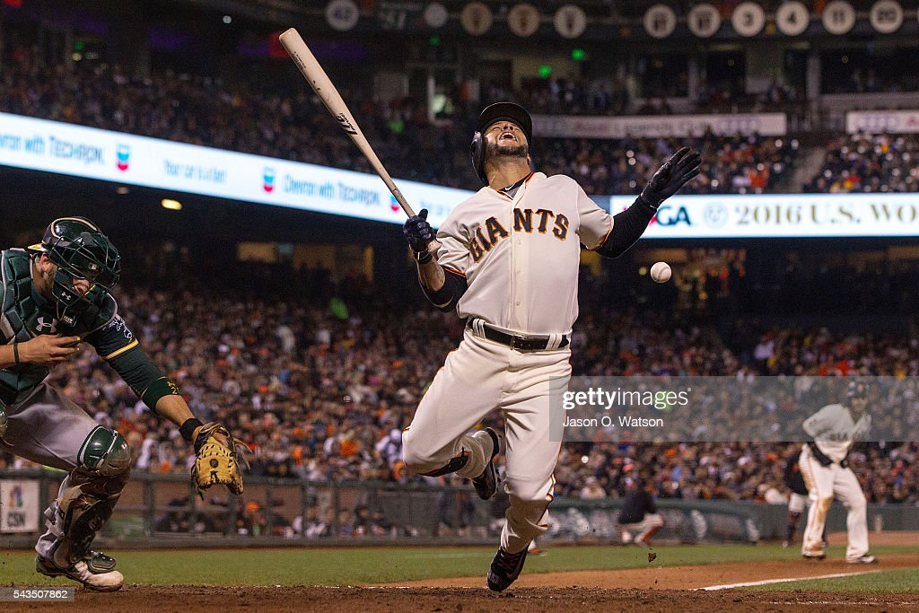Gregor Blanco #7 of the San Francisco Giants reacts after getting hit by a pitch from Marc Rzepczynski (not pictured) of the Oakland Athletics during the sixth inning at AT&T Park on June 28, 2016 in San Francisco, California.