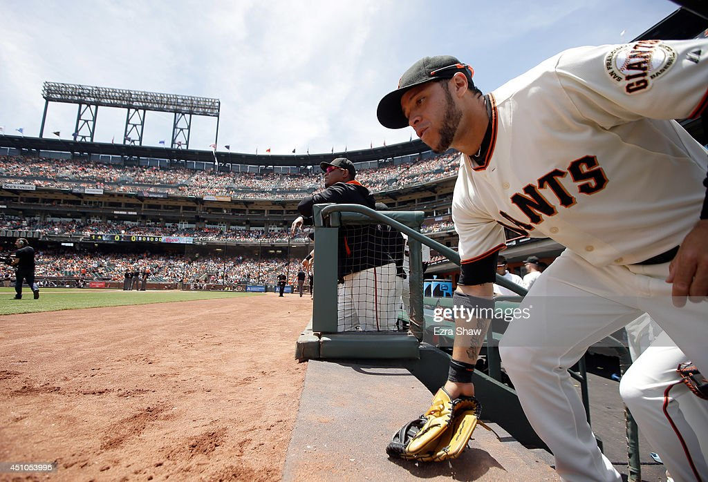 Gregor Blanco #7 of the San Francisco Giants runs out of the dugout for their game against the Colorado Rockies at AT&T Park on June 14, 2014 in San Francisco, California.