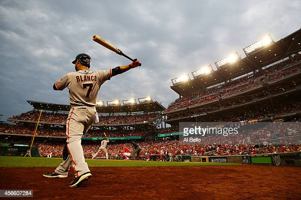 Gregor Blanco of the San Francisco Giants stands on deck during Game One of the National League Division Series against the Washington Nationals at...