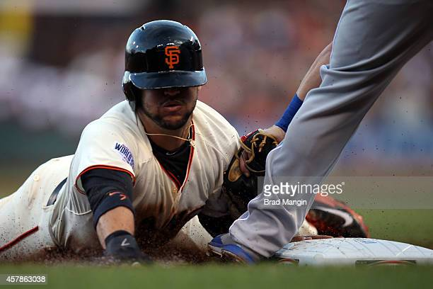Gregor Blanco of the San Francisco Giants steals third base in the bottom of the first inning during Game 4 of the 2014 World Series against the...