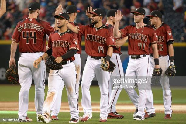 Gregor Blanco Reymond Fuentes and Jeremy Hazelbaker of the Arizona Diamondbacks celebrate with teammates after closing out the MLB game against the...