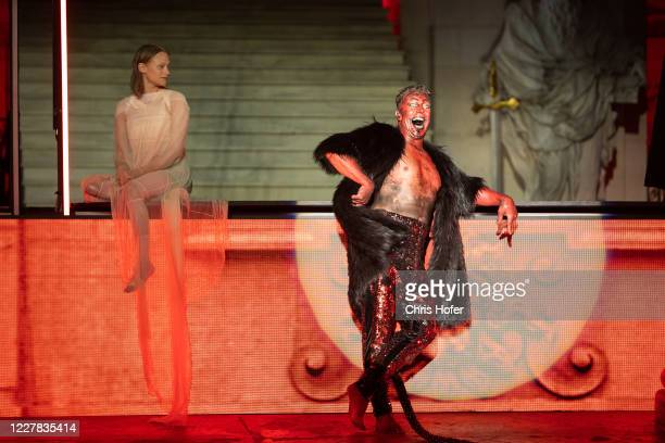 """Gregor Bloeb as """"Teufel"""" and Mavie Hoerbiger as """"Werke"""" performing on stage during the outdoor TV and press rehearsal of the production """"Jedermann""""..."""
