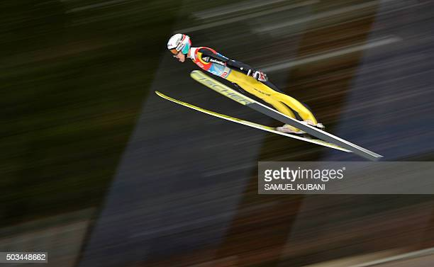 TOPSHOT Gregor Deschwanden of Switzerland soars through the air during his trial jump at the fourth stage of the Four Hills ski jumping tournament in...