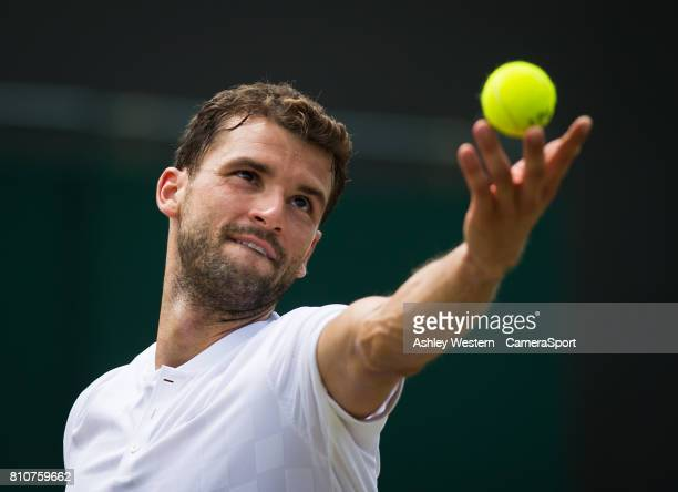 Gregor Dimitrov of Bulgaria in action during his victory over Dudi Sela of Israel in their Men's Singles Third Round Match at Wimbledon on July 8...