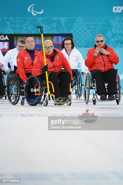Gregor Ewan of Great Britain competes in the Round Robin Session 7 during day four of Sochi 2014 Paralympic Winter Games at Ice Cube Curling Center...