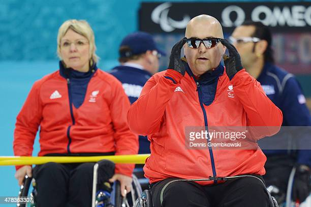 Gregor Ewan of Great Britain reacts during the Wheelchair Curling Round Robin Session 11 during day six of Sochi 2014 Winter Paralympic Games at Ice...