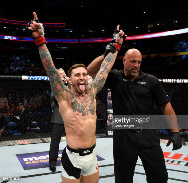 Gregor Gillespie celebrates his knockout victory over Andrew Holbrook in their lightweight bout during the UFC 210 event at KeyBank Center on April 8...