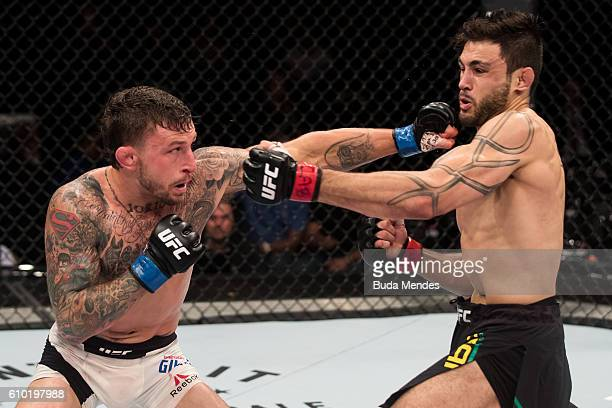 Gregor Gillespie of the United States punches Glaico Franca of Brazil in their lightweight UFC bout during the UFC Fight Night event at Nilson Nelson...