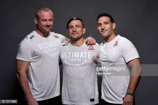 Gregor Gillespie poses for a post fight portraits with his team backstage during a UFC Fight Night event at Spectrum Center on January 27 2018 in...