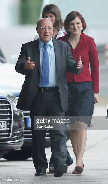 Gregor Gysi and Katja Kipping of the German leftwing party Die Linke arrive at the Chancellery for an extraordinary meeting with German Chancellor...