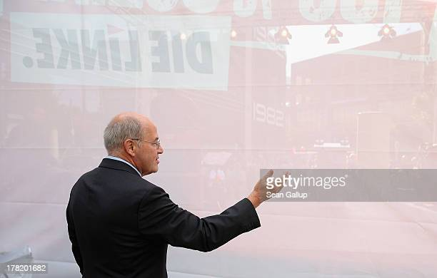 Gregor Gysi Chairman of the Bundestag faction of the German leftwing party Die Linke stands behind stage before speaking to supporters during an...