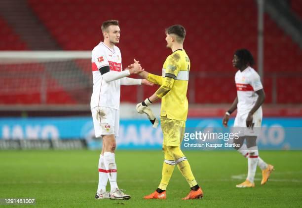 Gregor Kobel and Sasa Kalajdziz of VfB Stuttgart shake hands following the Bundesliga match between VfB Stuttgart and 1. FC Union Berlin at...