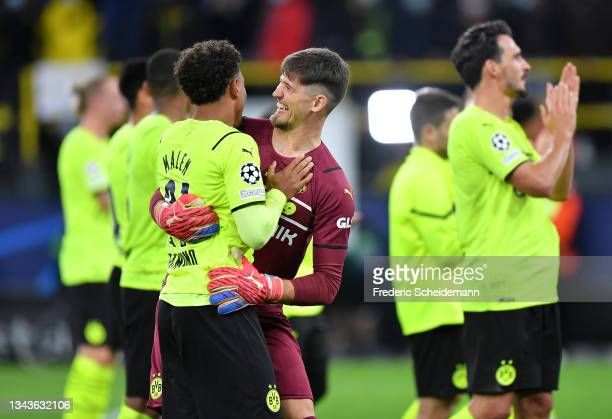 Gregor Kobel of Borussia Dortmund celebrates with teammate Donyell Malen after victory in the UEFA Champions League group C match between Borussia...