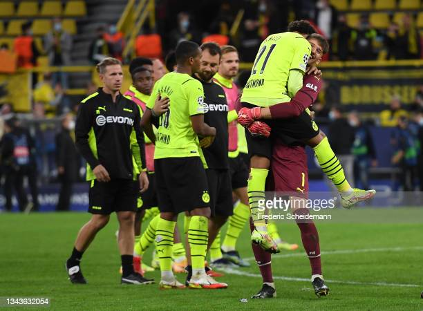 Gregor Kobel of Borussia Dortmund celebrates with teammate Edmund Addo after victory in the UEFA Champions League group C match between Borussia...