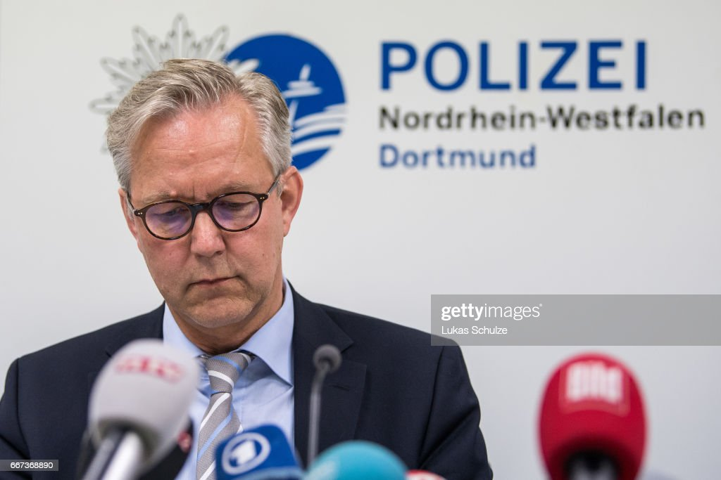 Gregor Lange, chief of Police Dortmund, speaks to the media during a press conference at the Police Headquarters Dortmund on April 11, 2017 in Dortmund, Germany. The UEFA Champions League match between Borussia Dortmund and AS Monaco was cancelled after the Borussia Dortmund team bus was damaged in an explosion. According to police an explosion detonated as the bus was leaving the hotel where the team was staying to bring them to their Champions League game against Monaco. One person, team member Marc Bartra, is reported injured.