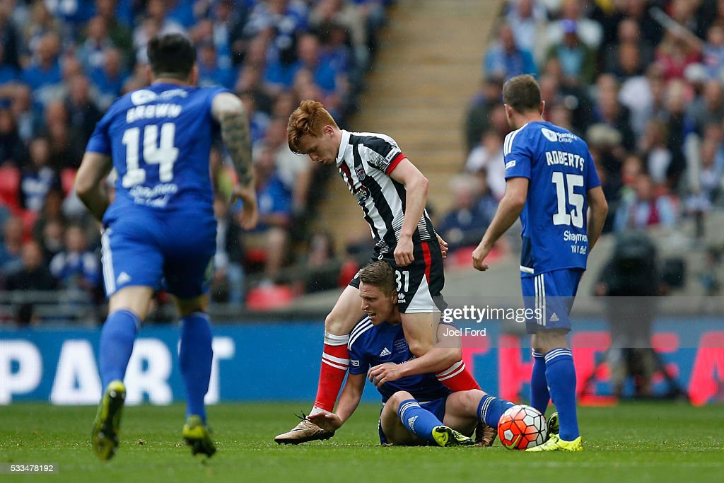 Gregor Robertson of Grimsby Town and Nicky Wroe of Halifax Town tussle for the ball during the FA Trophy Final match between Grimsby Town FC v FC Halifax Town at Wembley Stadium on May 22, 2016 in London, England.