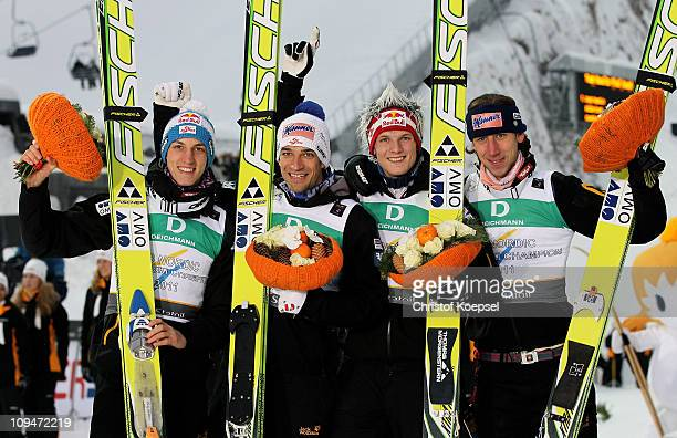 Gregor Schlierenzauer, Andreas Kofler, Thomas Morgenstern and Martin Koch of Austria celebrate after winning the gold medal in the Men's Ski Jumping...