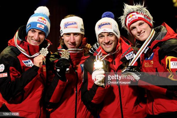 Gregor Schlierenzauer, Martin Koch, Andreas Kofler and Thomas Morgenstern of Austria pose with the gold medals won in the Men's Ski Jumping Team...