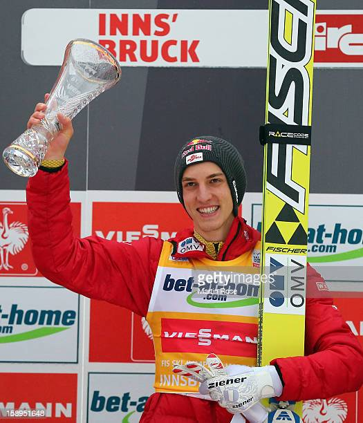 Gregor Schlierenzauer of Austria celebrates after winning the final round for the FIS Ski Jumping World Cup event of the 61st Four Hills ski jumping...