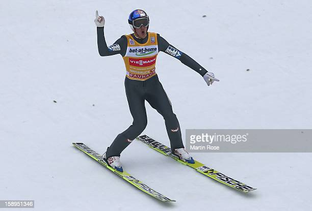 Gregor Schlierenzauer of Austria celebrates after winning the FIS Ski Jumping World Cup event of the 61st Four Hills ski jumping tournament at...
