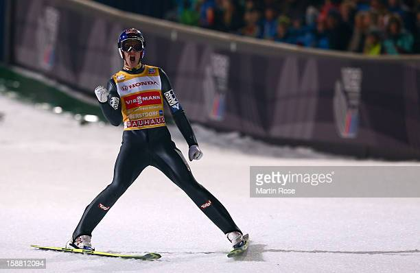 Gregor Schlierenzauer of Austria celebrates during the final round second leg for the FIS Ski Jumping World Cup event of the 61st Four Hills ski...