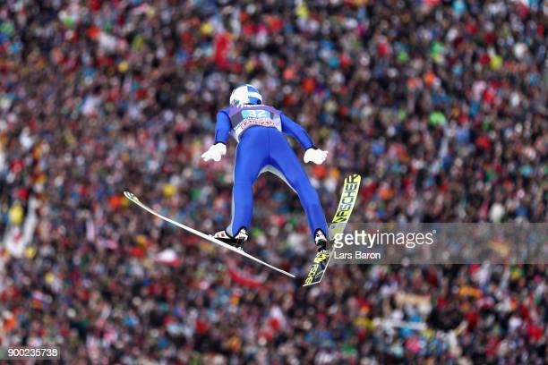 Gregor Schlierenzauer of Austria competes at the first round on day 4 of the FIS Nordic World Cup Four Hills Tournament ski jumping event at...