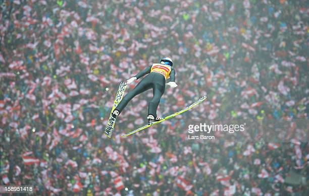 Gregor Schlierenzauer of Austria competes during the first round for the FIS Ski Jumping World Cup event of the 61st Four Hills ski jumping...