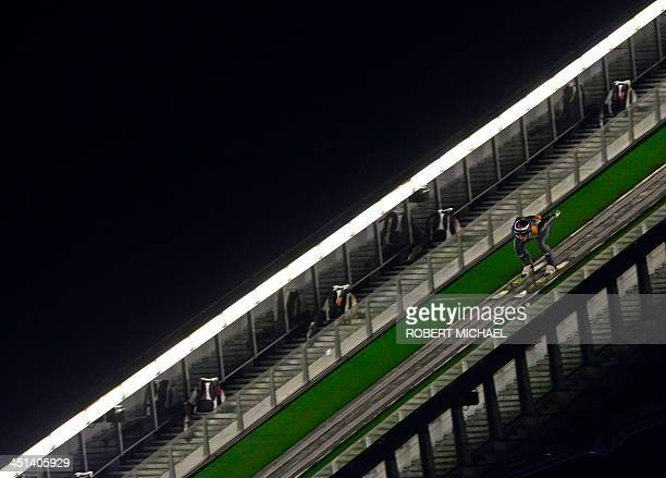 Gregor Schlierenzauer of Austria competes during the qualifying of the FIS Ski Jumping World Cup on November 22, 2013 in Klingenthal, eastern...