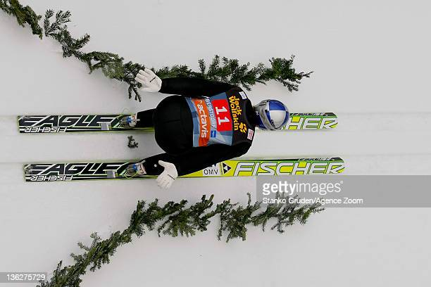 Gregor Schlierenzauer of Austria skis on the way to taking 1st place during the FIS Ski Jumping World Cup Vierschanzentournee on December 30 2011 in...