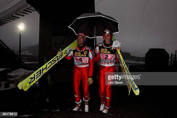 Gregor Schlierenzauer of Austria walks up to the hill with team mate Andreas Kofler prior to the trail round for the FIS Ski Jumping World Cup event...