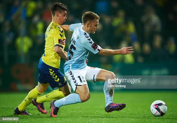 Gregor Sikosek of Brondby IF and Troels Klove of Sonderjyske compete for the ball during the Danish Alka Superliga match match between Sonderjyske...