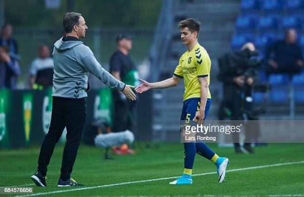 Gregor Sikosek of Brondby IF shake hands with Alexander Zorniger head coach of Brondby IF after receiving a red card from referee Morten Krogh during...